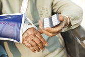 Asian senior woman taking medicines — Stock Photo