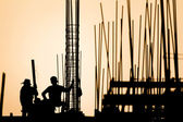 Construction worker silhouette on the work place — Stock Photo