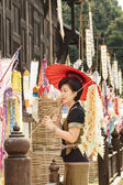 Woman with religion flag at temple in Songkran festival — Foto Stock