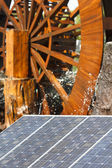 Green economy and sustainability: solar and water energy — Stock Photo