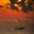 Fisherman on the boat over dramatic sunrise — Stock Photo #46525563