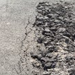 Cracked asphalt road — Stock Photo #46957751