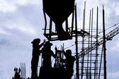 Construction worker silhouette on the work place — Stockfoto