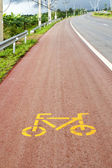 Bicycle lane sign on the road — Stock Photo