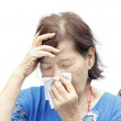 Asian senior woman suffering from headache and cold — Stock Photo