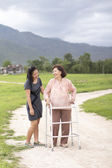 Young asian is taking care the senior woman with walker in farm — Stock Photo