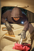 Thief stealing wallet  from car — Stock Photo