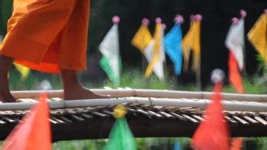 Buddhist Monk walk on bamboo bridge in temple , Chiangmai Thailand — Stock Video