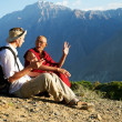 Tourist and monk in mountains — Stock Photo #12539892
