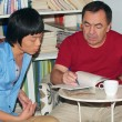 Adult male teaches Asian teen — Foto Stock