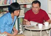 Adult male teaches Asian teen — Stock Photo