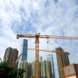Building crane and skyscrapers in Hongkong - Stock Photo