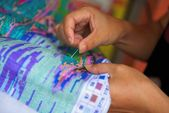 Hand with needle embroidery in China — Stock Photo