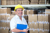 Storekeeper at work in warehouse — Stock Photo