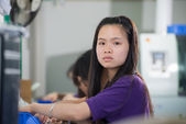 Female worker on electronic factory in China — Stock Photo