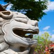 Chinese ancient lion head statue — Stock Photo