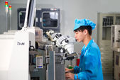 Chinese worker on factory check product — Stock Photo
