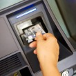 Bank card at an chinese ATM to issue money — Stock Photo