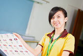 Chinese girl holding a proofing in printing house — Stock Photo