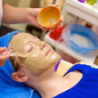 Face care by Chinese medicines massage — Stock Photo