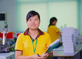 Female technologist on Chinese factory — Stock Photo
