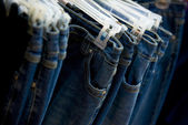 Jeans range in shop — Stock Photo