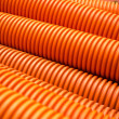 Orange plastic PVC pipes on industrial — Stock Photo #32792281