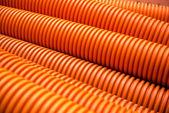 Orange plastic PVC pipes on industrial — Stock Photo