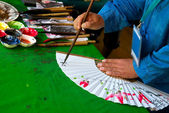 Korean traditional calligraphy on fans — Stock Photo