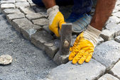 Worker make stone pavement — Stok fotoğraf