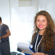 Business assistant, pretty woman on exhibition — Stock Photo