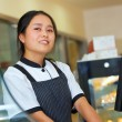 Beautiful asian girl seller in the coffee shop — Stock Photo