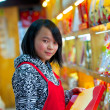 Pretty young asian seller in store — Foto Stock