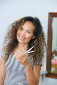 Home pretty asian hairdresser with scissors — Stock Photo