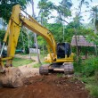 Stock Photo: Yellow loader mashine digging road