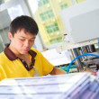 Chinese worker on plastic card production factory — Stock Photo