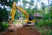 Yellow loader mashine digging the road — Stock Photo