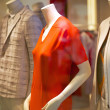 Mannequins in fashionable clothes in the shop window — Stock Photo #49263997