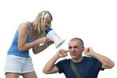 Wife screams into a megaphone to husband — Stock Photo