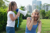 Little girl shouting into a megaphone — Stock Photo