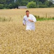 Busy young agronomist running — Stock Photo #12284046