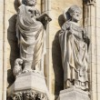 图库照片: Two statues of saints from tower of medieval Cathedral of Our Lady in Antwerp known from 1352