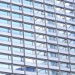 Modern building reflections in windows of another building — Stock Photo #12284295