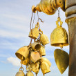 Bells on entry in buddhist temple in Thailand in evening — Stock Photo