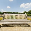 Royalty-Free Stock Photo: Big bench in garden in bright summer day