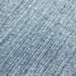 Closeup image of blue fabric with white threads — Stock Photo