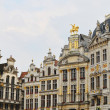 Grand Place in Brussels at sundown and surrounding medieval buildings — Stock Photo