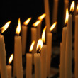 Rows of firing candles in catholic church — Stock Photo #12284590