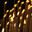 Rows of firing candles in catholic church — Stock Photo #12284595