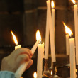 Rows of firing candles in catholic church — Stock Photo #12284600